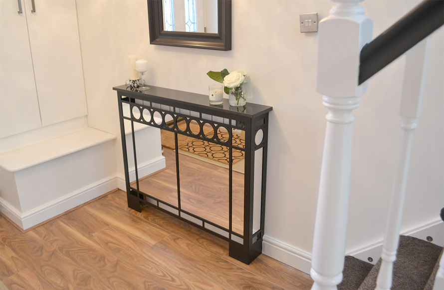 Art DECO radiator cover in satin black with mirror front panel and sides and granite top