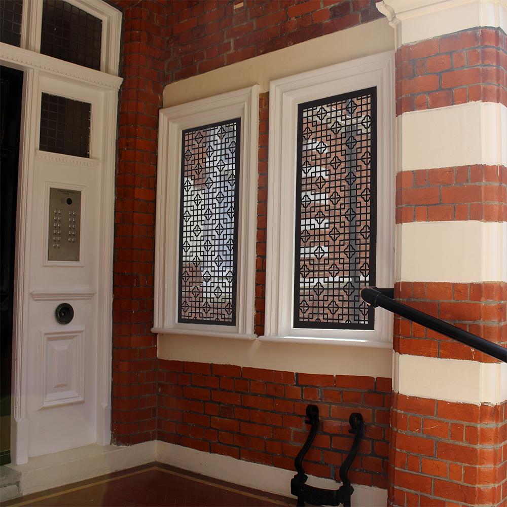 BAKER ST Laser cut window security screens in door entrance