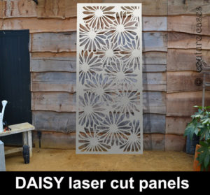 Garden panels in laser cut metal in floral daisy pattern