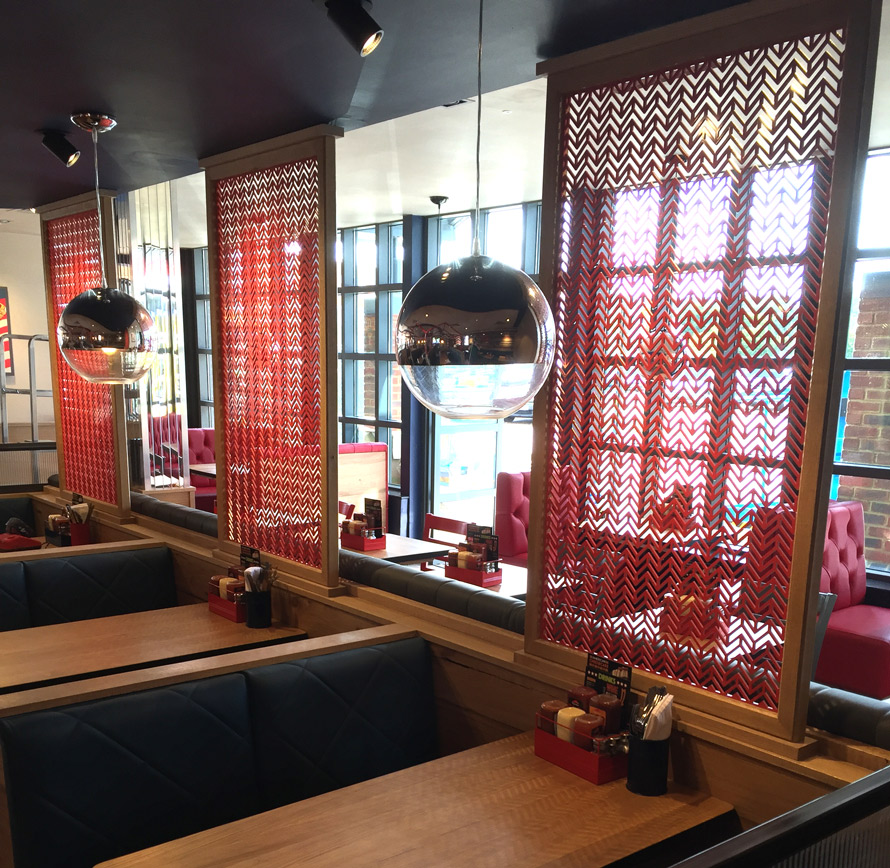 Laser cut screens in Chevron design for Pizza Hut UK