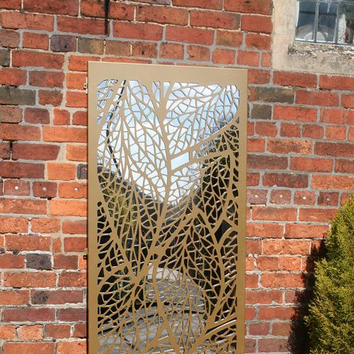 Leaf Pattern Outdoor Garden Screen In Gold On Brick Wall