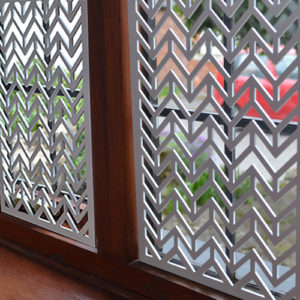 Interior window screens in laser cut metal
