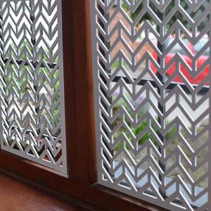 Interior window screens in laser cut metal