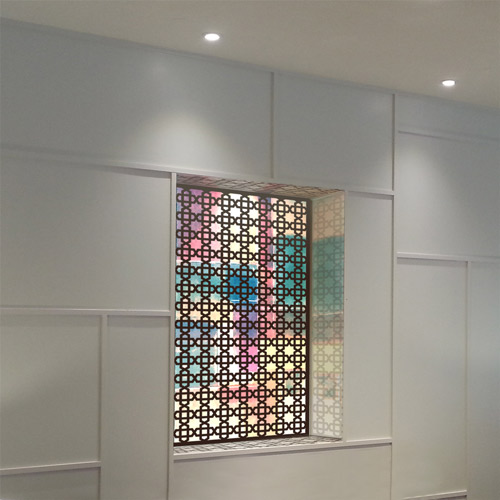 wall panels with lights in arabic pattern