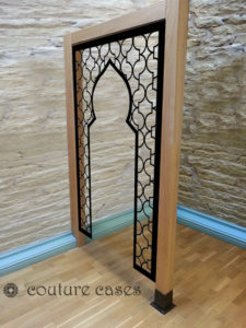 Open arabic minaret laser cut panel in wood room partition