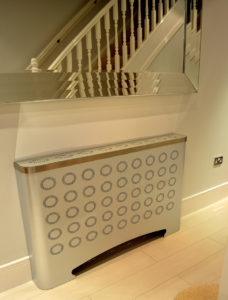 Contemporary hallway radiator covers in galvanised modern designs