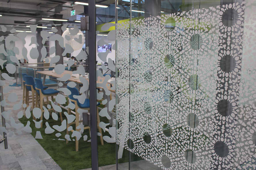 Nottingham lace laser cut vinyl graphics on wall partitions