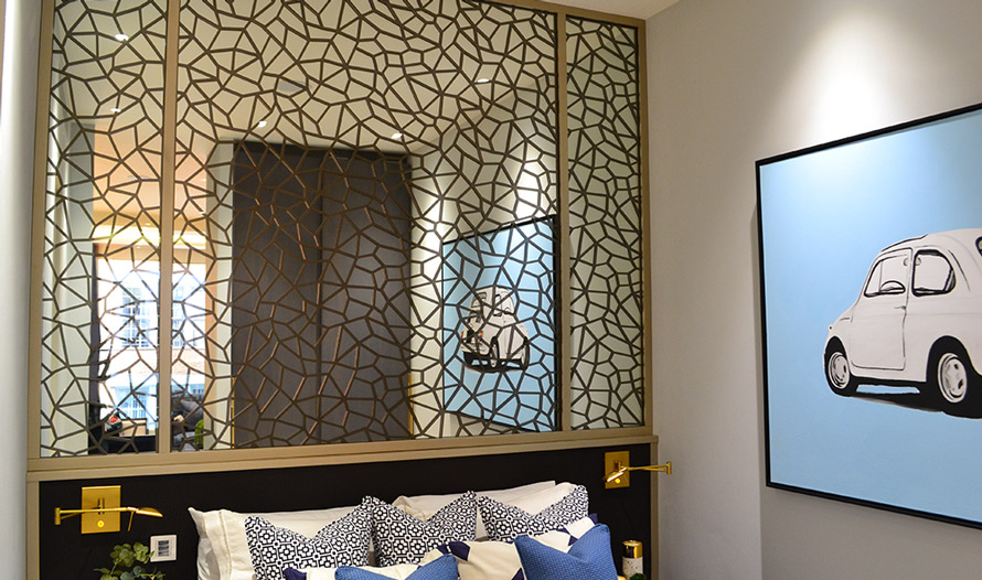 Decorative laser cut bronze screens in bedroom wall mirror