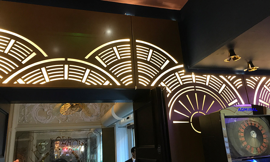 Hippodrome casino london laser cut metal wall screen with illuminated white lighting