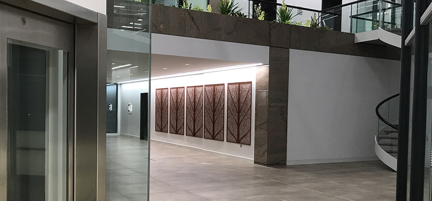 Laser cut wall art panels in commercial entrance hall