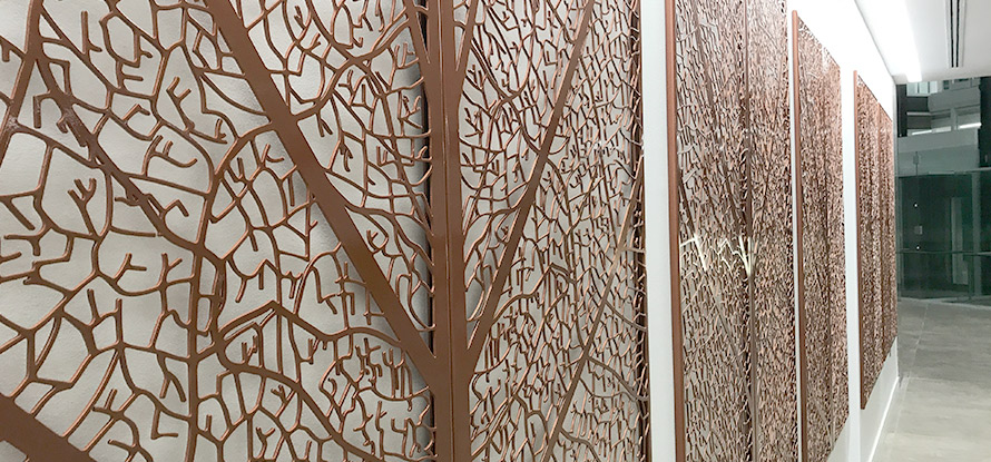 Decorative wall panels in copper leaf design
