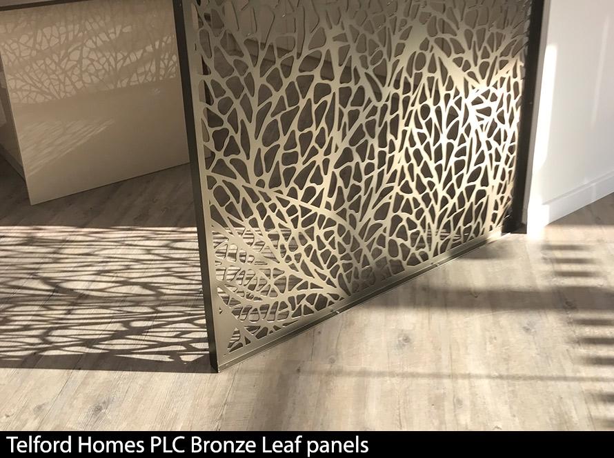 Dark bronze room partition on light ash floorin