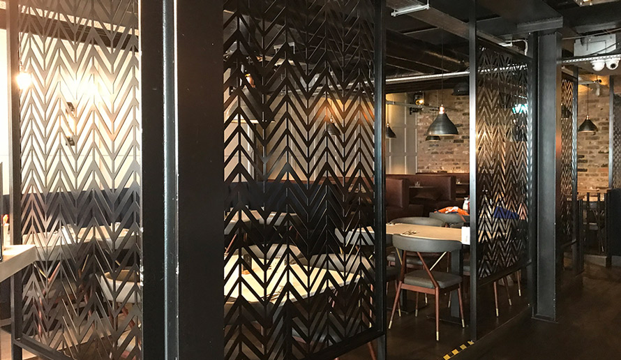 Bespoke laser cut screens restaurant dining